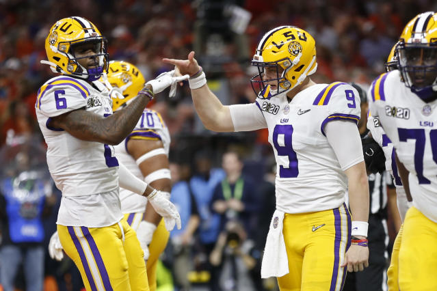 LSU quarterback Joe Burrow threw three TDs and ran for one in the first half against Clemson. (AP Photo/Gerald Herbert)