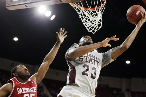Mississippi State forward Arnett Moultrie (23) shoots a layup past Arkansas guard Brandon Mitchell (25) during the first half of their NCAA college basketball game, Saturday, March 3, 2012, in Starkville, Miss. (AP Photo/Rogelio V. Solis)