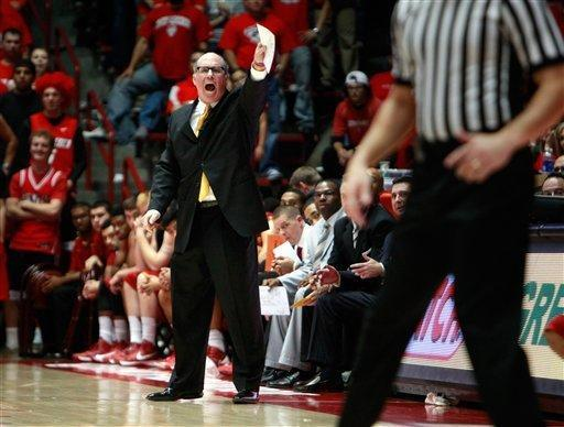Southern California head coach Kevin O'Neil shouts at his team in the second half of an NCAA college basketball game against New Mexico at The Pit in Albuquerque, N.M. Wednesday, Dec. 5, 2012. New Mexico won 75-67. (AP Photo/Eric Draper)