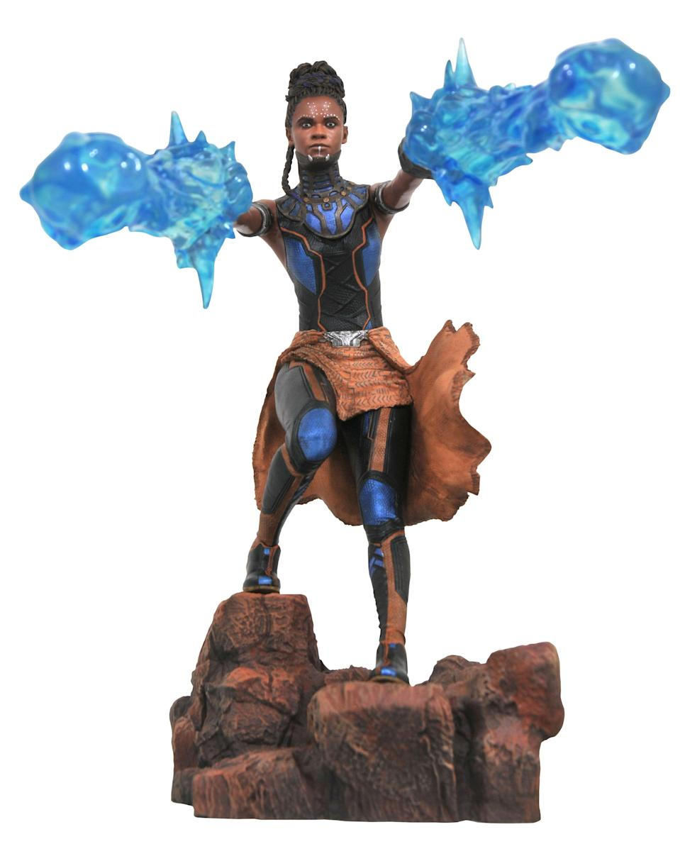 """<p>Shuri's <a rel=""""nofollow"""" href=""""https://www.yahoo.com/entertainment/black-panther-breakout-shuri-crowned-best-disney-princess-social-media-171338599.html"""" data-ylk=""""slk:Disney Princess bretheren;outcm:mb_qualified_link;_E:mb_qualified_link;ct:story;"""" class=""""link rapid-noclick-resp yahoo-link"""">Disney Princess bretheren</a> may talk to fish and fly on magic carpets, but they don't have twin Vibranium gauntlets. Those sonic energy-generating weapons are front and center in this dynamic 9-inch tall display. $45 (Photo: Diamond Select Toys) </p>"""