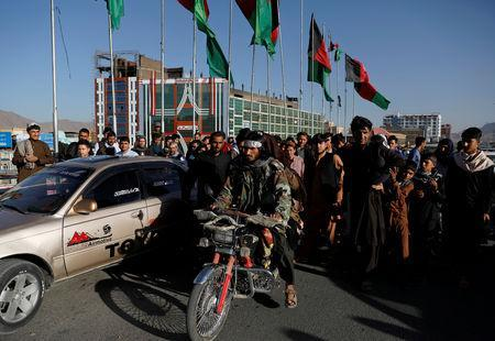 FILE PHOTO: Taliban on a motorbike ride among people in Kabul, Afghanistan June 16, 2018. REUTERS/Mohammad Ismail/File Photo