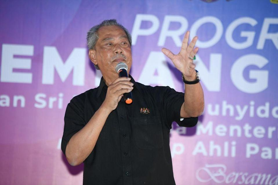 Prime Minister Tan Sri Muhyiddin Yassin delivers a speech during a meet-and-greet event at a restaurant in Pagoh October 30, 2020. — Bernama pic