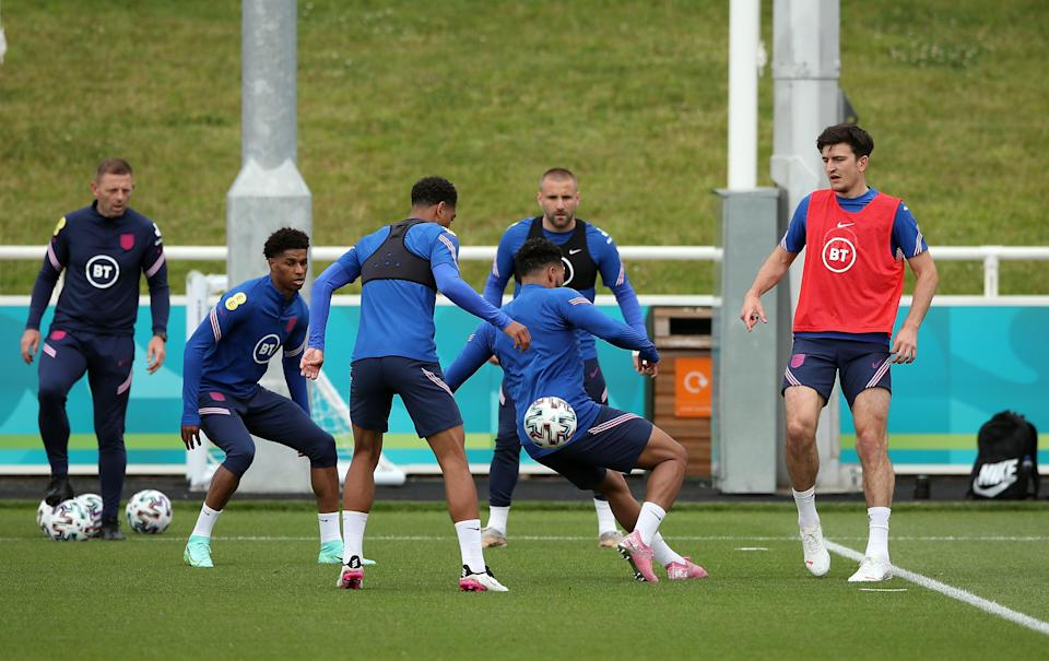 Harry Maguire (right) was among the England players who trained on Monday (PA Wire)