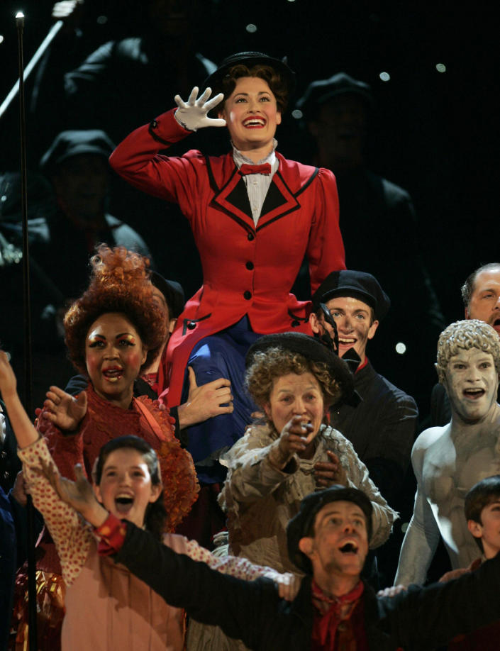 "FILE - Rebecca Luker, background, leads a performance of songs from ""Mary Poppins"" at the 61st Annual Tony Awards in New York on June 10, 2007. Luker, 59, a three-time Tony nominated actor who starred in some of the biggest Broadway hits of the past three decades, died Wednesday, Dec. 23, 2020, said Sarah Fargo, her agent. The actor went public in 2020 saying he had been diagnosed with amyotrophic lateral sclerosis, known as A.L.S. or Lou Gehrig's disease. (AP Photo/Jeff Christensen, File)"