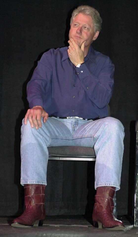 U.S. President Bill Clinton, in cowboy boots and faded blue jeans listens to remarks at a National Tribute to President Clinton Gala at the MCI Center in Washington, May 24, 2000. The Democratic National Committee raised a record $26 million at the fundraiser. (Reuters)