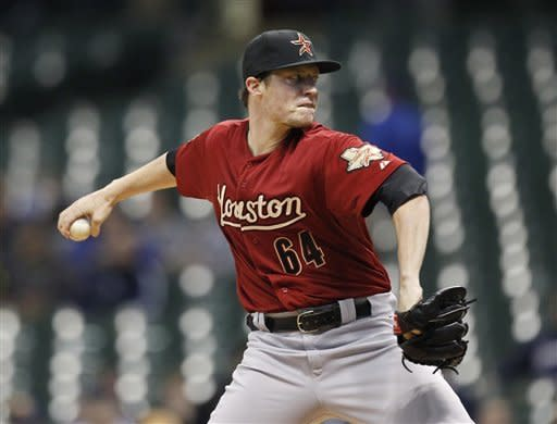 Houston Astros starting pitcher Lucas Harrell throws against the Milwaukee Brewers during the first inning of a baseball game Monday, April 23, 2012, in Milwaukee. (AP Photo/Jeffrey Phelps)