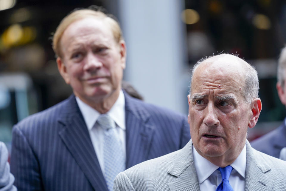 Nicholas Papain, right, attorney for retired NYPD Detective Barbara Burnette, who worked on the World Trade Center pile for 23 days after the terrorist attacks in 2001, is former New York Gov. George Pataki during a news conference, Wednesday, Sept. 8, 2021, in New York. Two decades after the collapse of the World Trade Center, people are still coming forward to report illnesses that might be related to toxic dust that billowed over the city after the terror attack. (AP Photo/Mary Altaffer)