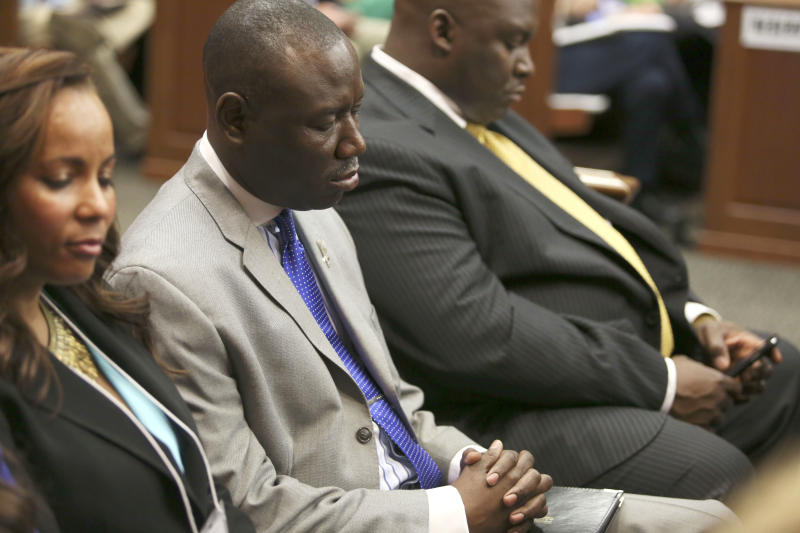 Attorneys Natalie Jackson, Benjamin Crump, and Daryl Parks, from left, sit in for the Trayvon Martin family during George Zimmerman's trial in Seminole circuit court in Sanford, Fla. on Saturday, July 13, 2013. Jurors found Zimmerman not guilty of second-degree murder in the fatal shooting of 17-year-old Martin in Sanford, Fla. The six-member, all-woman jury deliberated for more than 15 hours over two days before reaching their decision Saturday night. (AP Photo/Gary W. Green, Pool)