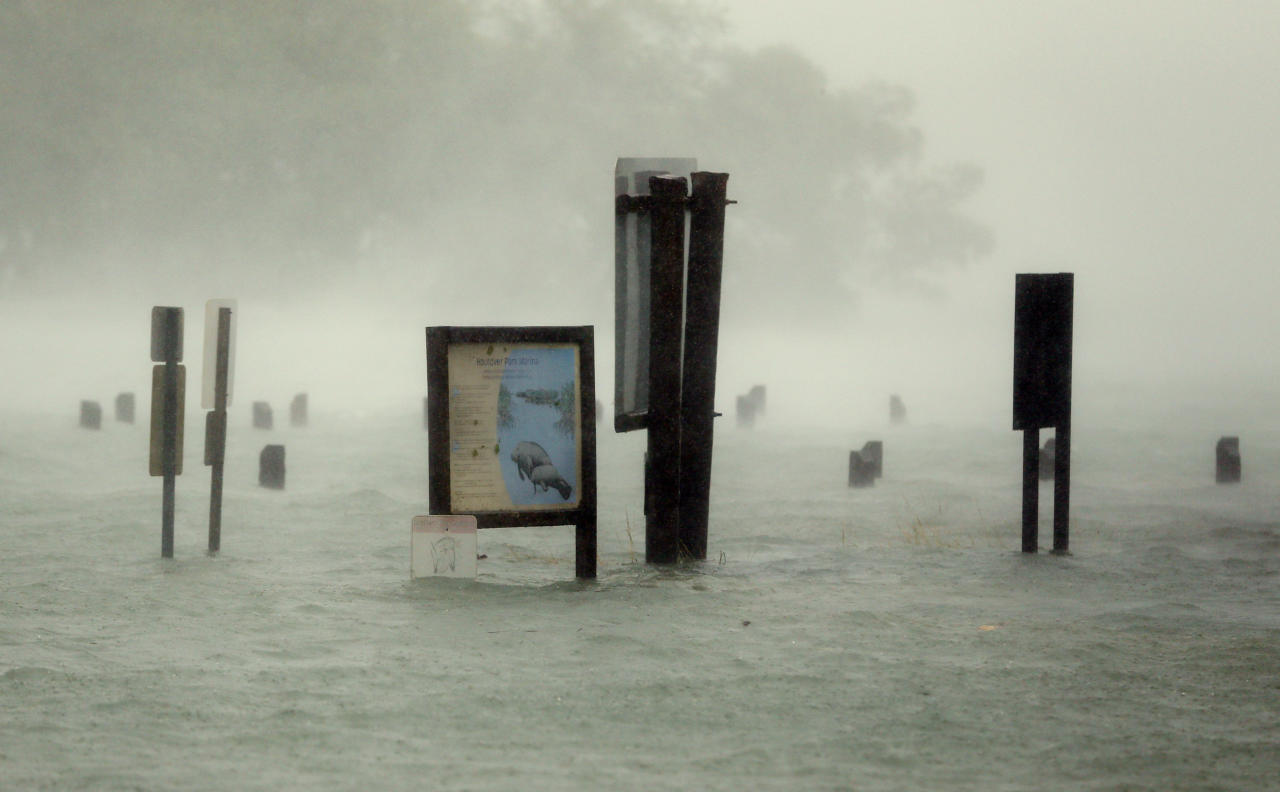"""<p></p><p>Flood waters rise around signs at the Haulover Marine Center at Haulover Park in North Miami Beach, Florida. State governor Rick Scott warned people that only a small amount of water could have a dangerous effect. He said: """"Stay inside. Stay safe."""" (AP Photo/Wilfredo Lee) </p><p></p>"""