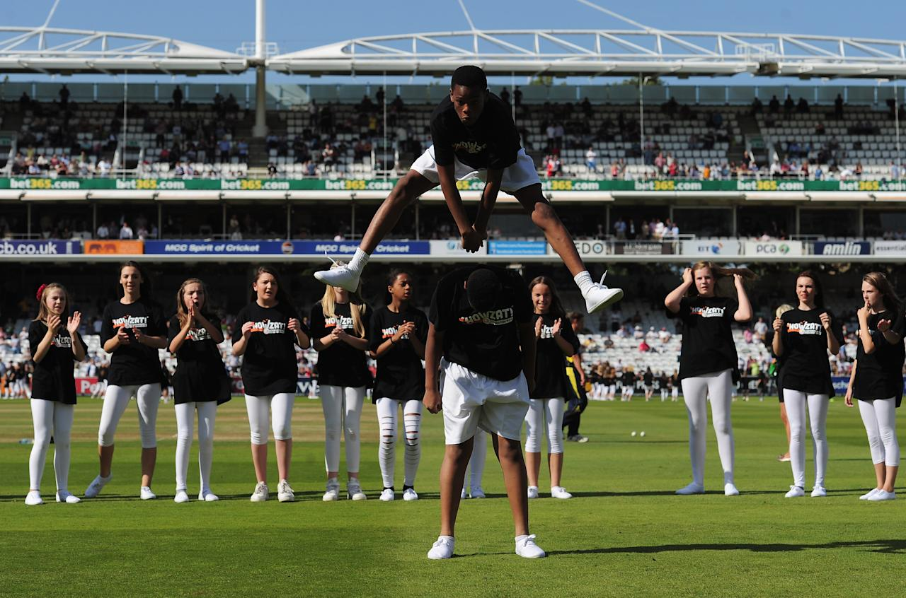 LONDON, ENGLAND - SEPTEMBER 15:  Children dance on the pitch at the lunch interval during the Clydesdale Bank Pro40 Final between Hampshire and Warwickshire at Lord's Cricket Ground on September 15, 2012 in London, England.  (Photo by Shaun Botterill/Getty Images)