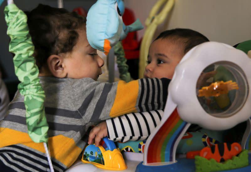 Mohamed Abdallah's biological son Soliman and Dawood, the orphan Mohamed sponsors, play together in their home in Cairo