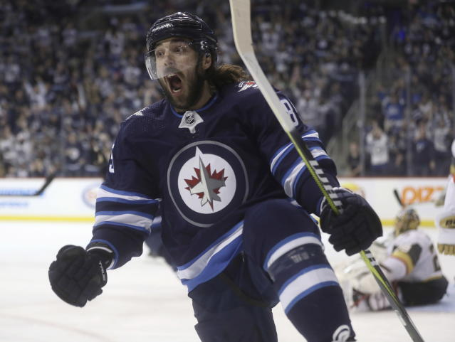 Winnipeg Jets' Mathieu Perreault celebrates after scoring on Vegas Golden Knights goaltender Marc-Andre Fleury (29) during the second period of an NHL hockey game Tuesday, Jan. 15, 2019, in Winnipeg, Manitoba. (Trevor Hagan/The Canadian Press via AP)