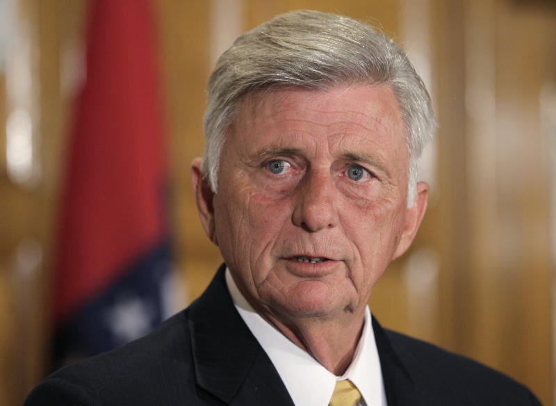 Arkansas Gov. Mike Beebe answers questions about the state's participation in the federal health care law at the Arkansas state Capitol in Little Rock, Ark., Monday, July 2, 2012. (AP Photo/Danny Johnston)