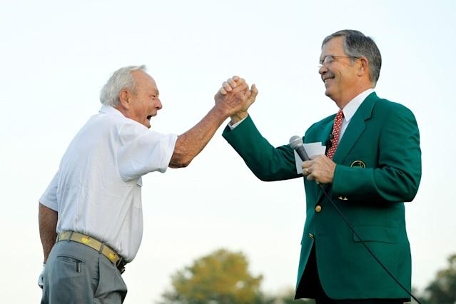 <p>Augusta National Golf Club chairman William Porter Payne (L) high fives honorary starter Arnold Palmer after his tee shot on the first hole during the start of first round of the 2012 Masters Tournament at Augusta National Golf Club on April 5, 2012 in Augusta, Georgia. (Photo by Streeter Lecka/Getty Images) </p>