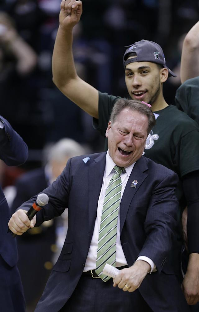 Michigan State head coach Tom Izzo celebrates after his team defeated Michigan 69-55 in an NCAA college basketball game in the championship of the Big Ten Conference tournament on Sunday, March 16, 2014, in Indianapolis. Michigan State guard Denzel Valentine, top, also reacts. (AP Photo/Michael Conroy)
