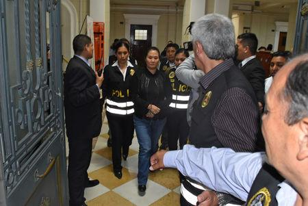 Opposition leader Keiko Fujimori is escorted by police officers after the judge ordered her back to jail pending a trial over allegations she used her conservative party to launder money for Brazilian construction company Odebrecht in Lima, Peru October 31, 2018. Courtesy of Justice Palace/ Handout via REUTERS