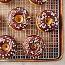 """<p>Who doesn't love a good donut? This baked variety is just as satisfying as the fried version, but SO much lighter. We can't resist a good chocolate glaze, but these would also be delicious rolled in cinnamon sugar, <a href=""""https://www.delish.com/uk/cooking/recipes/a29733984/easy-churros-recipe/"""" rel=""""nofollow noopener"""" target=""""_blank"""" data-ylk=""""slk:churro"""" class=""""link rapid-noclick-resp"""">churro</a>-style. </p><p>Get the <a href=""""https://www.delish.com/uk/cooking/recipes/a33430243/baked-donuts-recipe/"""" rel=""""nofollow noopener"""" target=""""_blank"""" data-ylk=""""slk:Baked Donuts"""" class=""""link rapid-noclick-resp"""">Baked Donuts</a> recipe.</p>"""