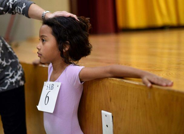 PHOTO: Six-year-old ballet dancer Charlotte Nebres prepares for auditioning as boys and girls ages 6 to 7 try out for The School of American Ballet Winter Term at the P.S. 124 Yung Wing school in New York, April 16, 2015. (Timothy A. Clary/AFP via Getty Images, FILE)
