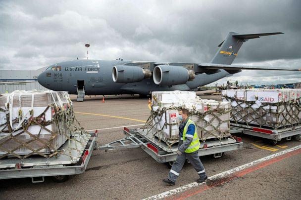 PHOTO: An airport worker walks past the batch of medical aid from the United States at Vnukovo International Airport outside Moscow, Russia, on June 4, 2020. (Pool/Reuters)