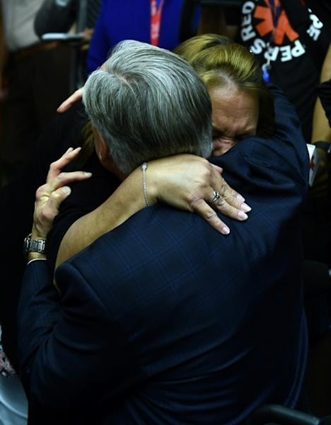 Texas Governor Greg Abbott embraces a grieving worshiper at Arcadia First Baptist Church at a memorial service for the victims of a mass shooting at Santa Fe High School