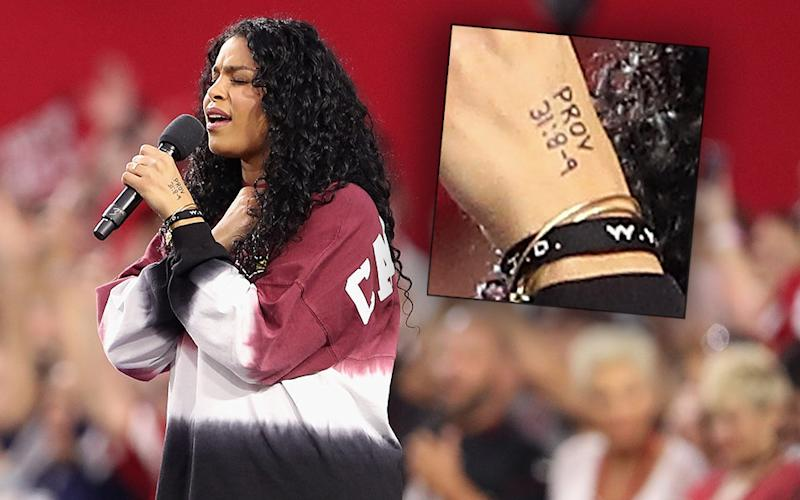 Singer Jordin Sparks performs the National Anthem before the start of the the NFL game between the Arizona Cardinals and the Dallas Cowboys at the University of Phoenix Stadium on September 25, 2017 in Glendale, Arizona.