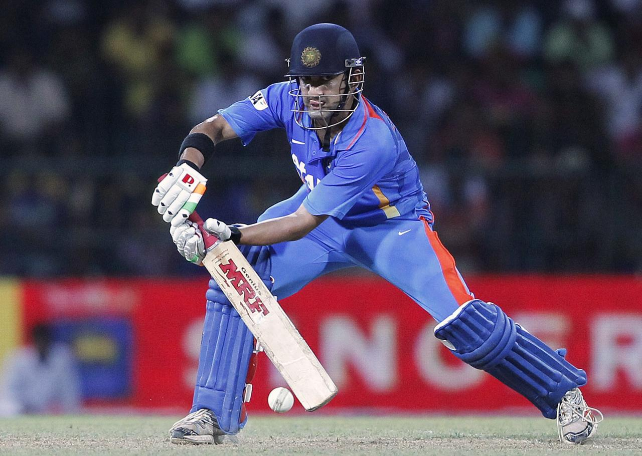 India's Gautam Gambhir plays a shot during their third One-Day International (ODI) cricket match against Sri Lanka in Colombo, July 28, 2012. REUTERS/Dinuka Liyanawatte (SRI LANKA - Tags: SPORT CRICKET)