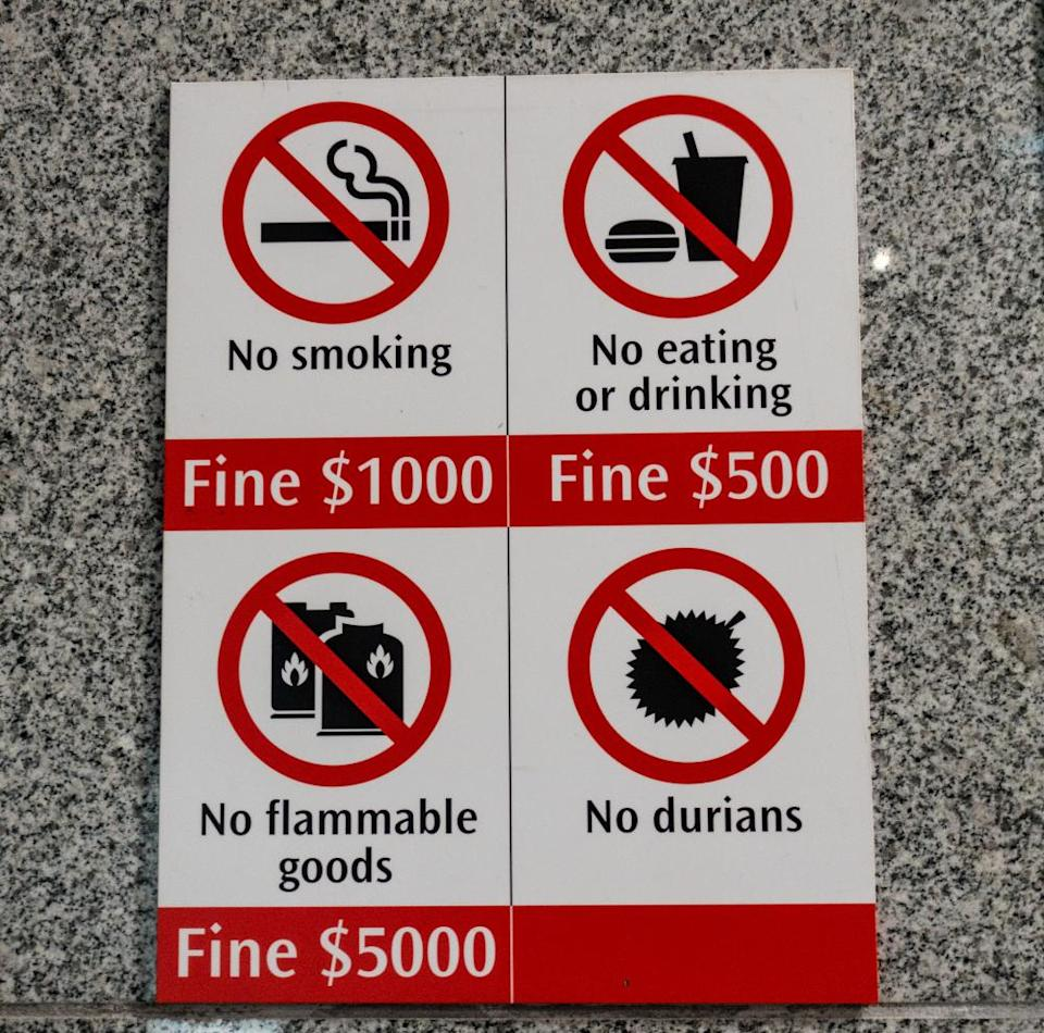 A sign in a subway station in Singapore prohibiting durian.
