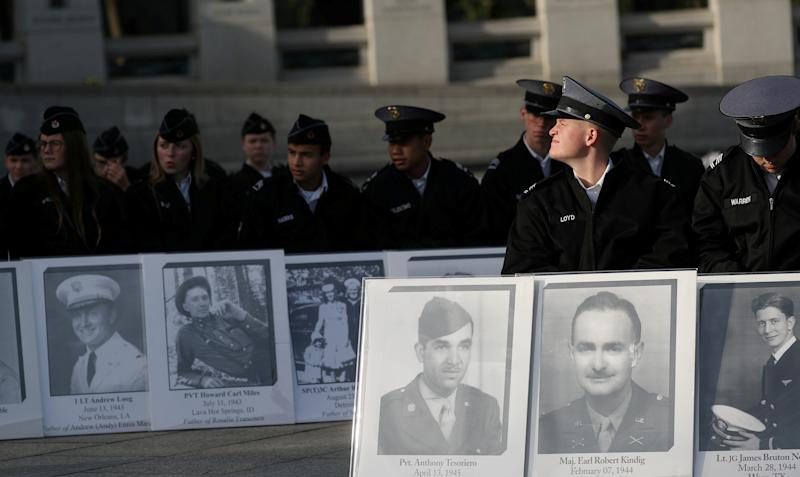 "Cadets hold portraits of loved ones who died during World War II at a Veterans Day Observance to honor ""the 16 million men and women who served in World War II"" in Washington, Nov. 11, 2019. (Photo: Siphiwe Sibeko/Reuters)"
