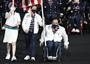 <p>Team USA flag bearers Melissa Stockwell and Charles Aoki entering the 2021 Paralympics opening ceremony during the Parade of Nations. </p>