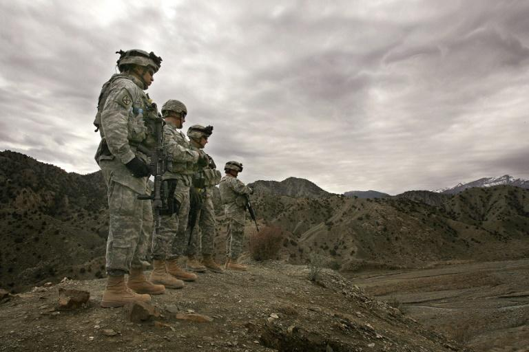 The Doha accord also calls for the gradual withdrawal of American troops (pictured 2006) and other foreign soldiers over a 14-month period -- the singular focus of the US diplomatic efforts (AFP Photo/JOHN D MCHUGH)