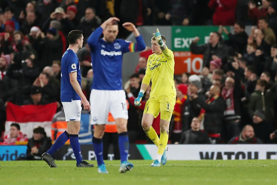 """Soccer Football - Premier League - Liverpool v Everton - Anfield, Liverpool, Britain - December 4, 2019  Everton's Jordan Pickford remonstrates with Michael Keane as Gylfi Sigurdsson looks dejected   Action Images via Reuters/Lee Smith  EDITORIAL USE ONLY. No use with unauthorized audio, video, data, fixture lists, club/league logos or """"live"""" services. Online in-match use limited to 75 images, no video emulation. No use in betting, games or single club/league/player publications.  Please contact your account representative for further details."""