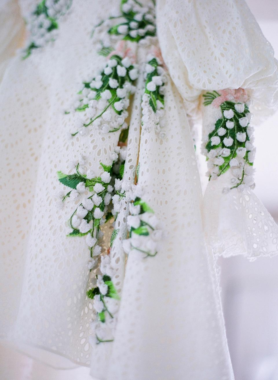 I have always loved the timeless elegance of Giambattista Valli's designs. Wanting my dress to reflect the romance and ease of the evening, I was immediately drawn to the vintage eyelet lace and hand-embroidered lily of the valley. It was me in a dress!