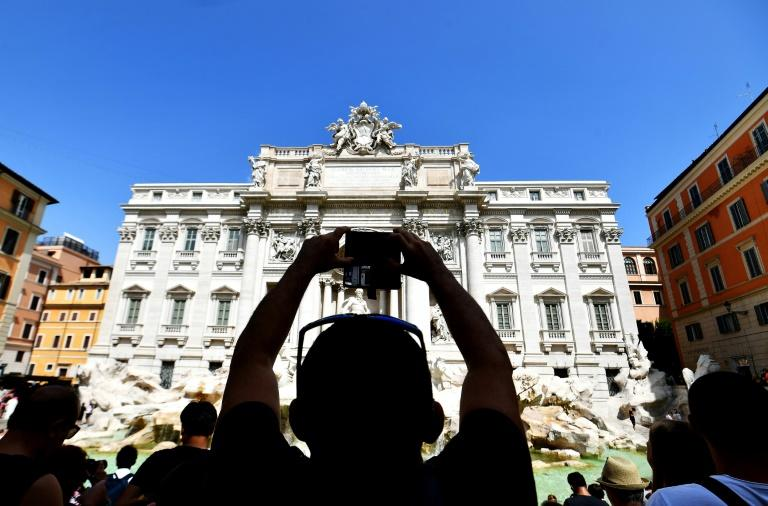 Thousands of people flock to the Trevi Fountain every day