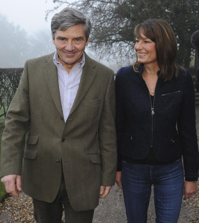 The parents of Kate Middleton, Michael and Carole (L), make a statement on the engagement of their daughter to Prince William, outside their home near the Berkshire village of Bucklebury November 16, 2010. Britain's Prince William is to marry his long-term girlfriend Kate Middleton next year, after an on-off courtship lasting nearly a decade, bringing months of speculation about his intentions to an end. REUTERS/Stefan Rousseau/POOL (BRITAIN - Tags: ROYALS PROFILE ENTERTAINMENT SOCIETY)