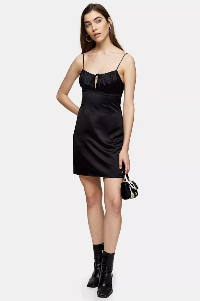 "<p>This <a href=""https://www.popsugar.com/buy/Topshop-Black-Gathered-Bust-Slip-Dress-581349?p_name=Topshop%20Black%20Gathered%20Bust%20Slip%20Dress&retailer=us.topshop.com&pid=581349&price=37&evar1=fab%3Auk&evar9=47582274&evar98=https%3A%2F%2Fwww.popsugar.com%2Ffashion%2Fphoto-gallery%2F47582274%2Fimage%2F47582304%2FTopshop-Black-Gathered-Bust-Slip-Dress&list1=shopping%2Cdresses%2Csummer%2Cfashion%20shopping&prop13=api&pdata=1"" rel=""nofollow"" data-shoppable-link=""1"" target=""_blank"" class=""ga-track"" data-ga-category=""Related"" data-ga-label=""https://us.topshop.com/en/tsus/product/gathered-bust-slip-9637494"" data-ga-action=""In-Line Links"">Topshop Black Gathered Bust Slip Dress</a> ($37, originally $55) is a classic.</p>"