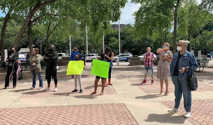 Some protesters objected to the plan for the county to withhold school funding.