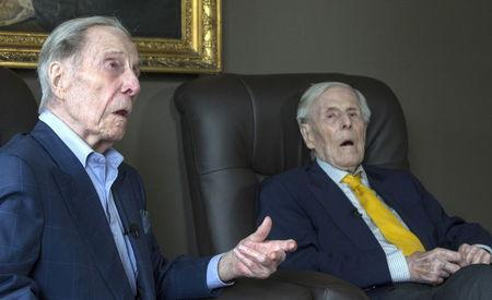 The world's oldest living twin brothers, Paulus and Pieter Langerock from Belgium, 102, sit in their living room at the Ter Venne care home in Sint-Martens-Latem, Belgium, August 11, 2015. REUTERS/Yves Herman
