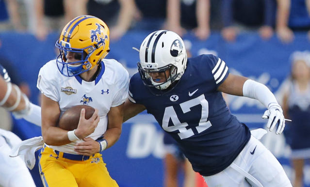 BYU linebacker Jackson Kaufusi (47) tackles McNeese State quarterback Cody Orgeron, left, in the second half during an NCAA college football game Saturday, Sept. 22, 2018, in Provo, Utah. (AP Photo/Rick Bowmer)