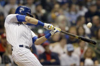 Milwaukee Brewers' Christian Yelich hits a solo home run during the third inning of a baseball game against the Philadelphia Phillies, Friday, May 24, 2019, in Milwaukee. (AP Photo/Aaron Gash)