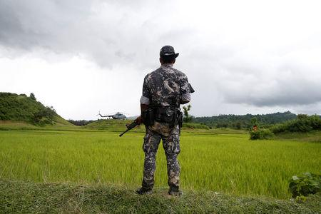 A Myanmar soldier stands near Maungdaw, north of Rakhine state