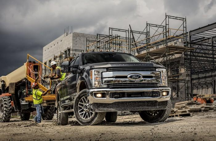 A black 2019 Ford F-350 Lariat, a heavy-duty pickup truck, on a construction site