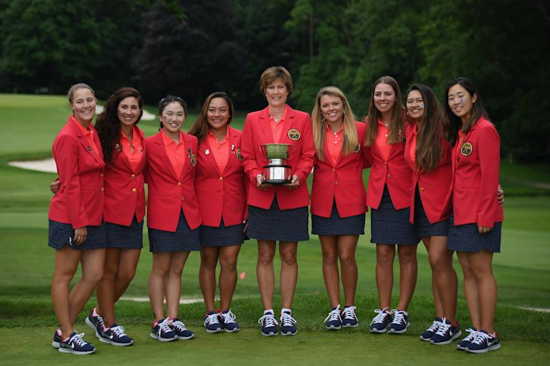 SCARSDALE, NY - JUNE 10: The United States team and Captain Virginia Derby Grimes celebrate with the Curtis Cup trophy after their 17-3 win over the Great Britain and Ireland team on day three of the 2018 Curtis Cup Match at Quaker Ridge Golf Club on June 10, 2018 in Scarsdale, New York. (Photo by Ross Kinnaird/R&A/R&A via Getty Images)