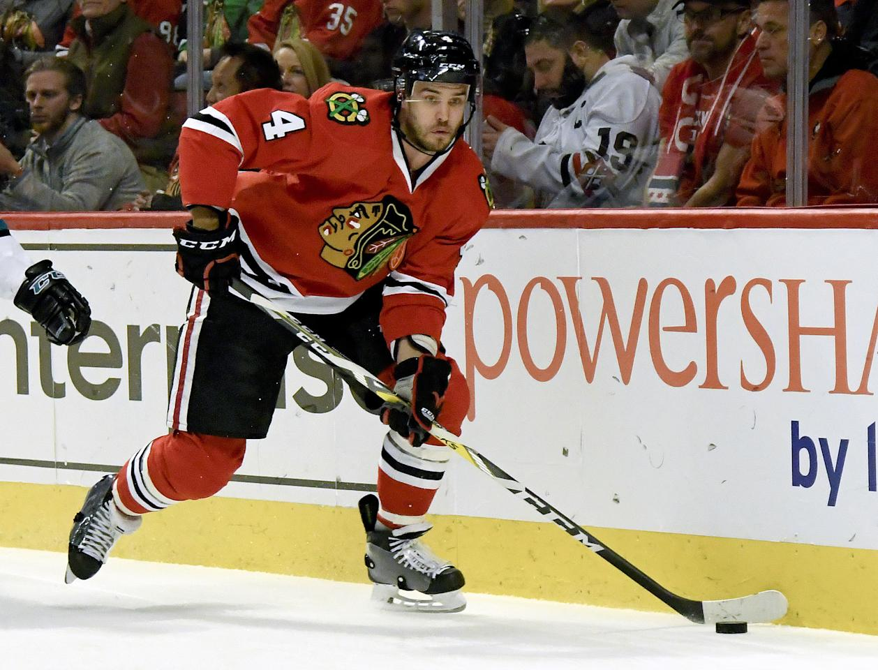 FILE - In this Dec. 18, 2016, file photo, Chicago Blackhawks defenseman Niklas Hjalmarsson (4), of Sweden, skates with the the puck during the first period of an NHL hockey game against the San Jose Sharks, in Chicago. The Arizona Coyotes have acquired Hjalmarsson in a trade with the Blackhawks. The 30-year-old Hjalmarsson had spent his entire 10-year career with Chicago, helping the Blackhawks to three Stanley Cup titles. (AP Photo/Matt Marton)