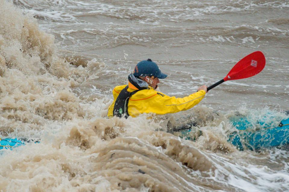 The inclement weather didn't put some people off their usual activities, like this kayaker in Clevedon, Somerset. (SWNS)