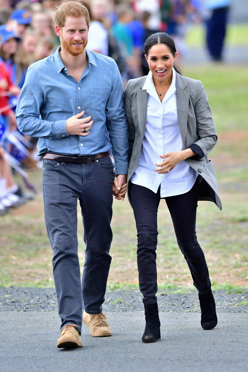 Meghan Markle and Prince Harry arrive in Dubbo on Wednesday. Photo: Getty, meghan markle prince harry dubbo, meghan markle prince harry australia, meghan markle serena williams jacket, meghan markle pregnant