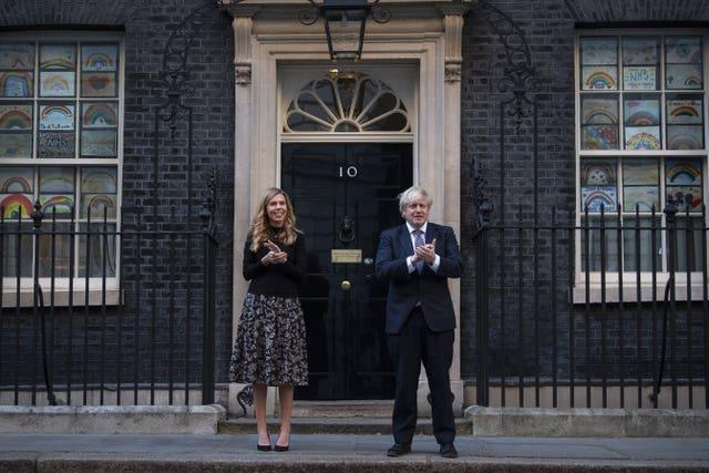 Carrie Symonds pictured with the Prime Minister outside Number 10