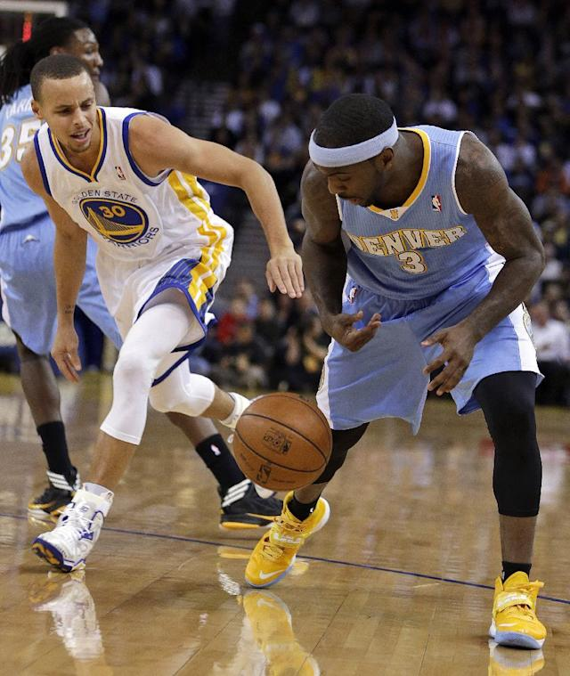 Denver Nuggets' Ty Lawson, right, and Golden State Warriors' Stephen Curry chase a loose ball during the first half of an NBA basketball game Wednesday, Jan. 15, 2014, in Oakland, Calif. (AP Photo/Ben Margot)