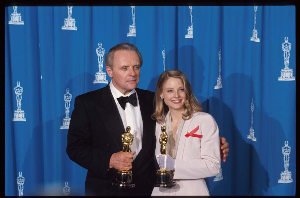 120528 13: Best Actor recipient Anthony Hopkins stands with Best Actress recipient Jodie Foster at the 64th annual Academy Awards March 30, 1992 in Los Angeles, CA. The Academy of Motion Picture Arts and Sciences awarded five Oscars to the film