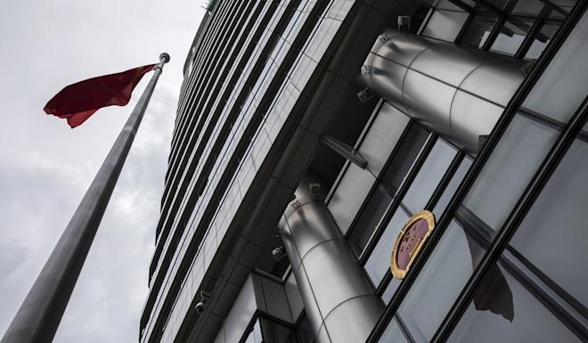 The Chinese flag and emblem are displayed outside the Office for Safeguarding National Security in Hong Kong, temporarily set up at the Metropark Hotel in Causeway Bay, shortly after the adoption of the new national security law. Photo: Bloomberg