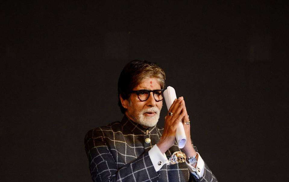 Indian Bollywood actor Amitabh Bachchan gestures during the inauguration of the 24th Kolkata International Film Festival in Kolkata on November 10, 2018. - More than 320 films from 70 countries will be screened during the seven-day festival. (Photo by Dibyangshu SARKAR / AFP)        (Photo credit should read DIBYANGSHU SARKAR/AFP via Getty Images)